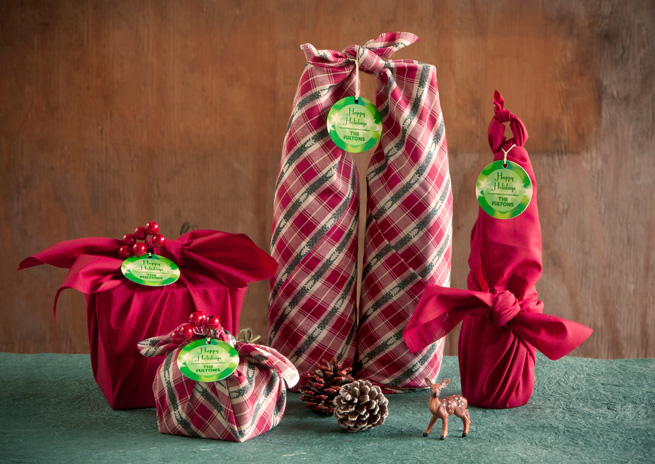 use a festive scarf for wrapping and it's like two gifts in one (via)