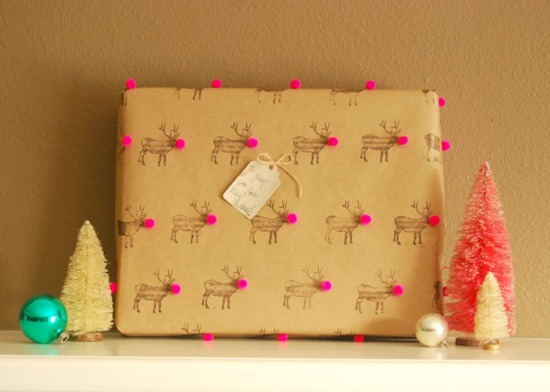 bonus points for not only adding festive stamps to your wrapping paper, but cute pom poms too (via)